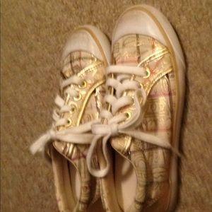 Women's coach tennis shoes. Gold. Size 5B Barrett